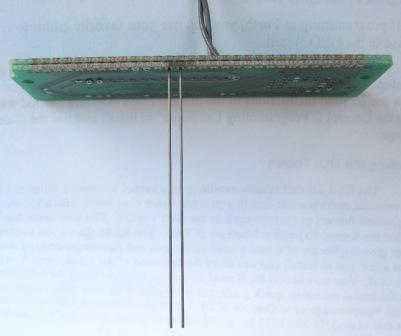 Long closely spaced parallel graphite electrodes used to measure the effect of fringing fields on conductivity cell constant.
