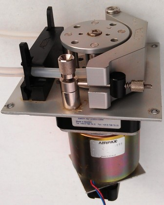 Pump head with attached motor and optical encoder.